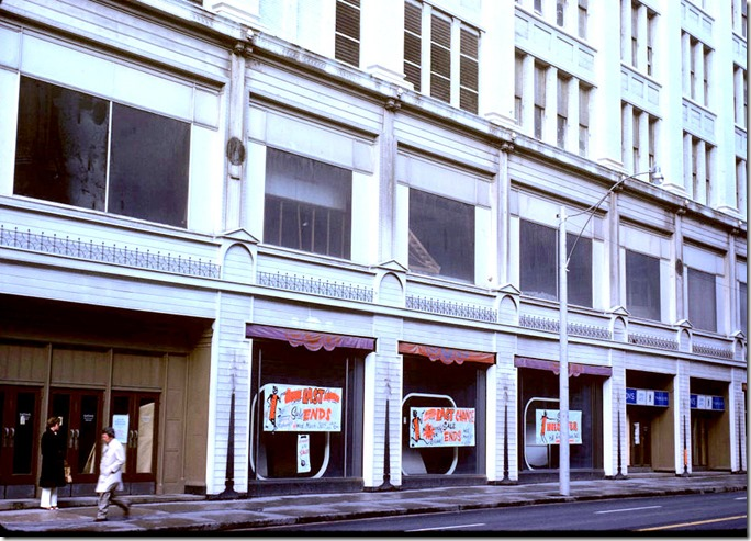 View of sale signs displayed along Queen Street Eaton's store windows – April 5, 1977