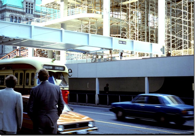 Close view of construction of Eaton Centre bridge from a streetcar stop on Queen Street West – September 25, 1978