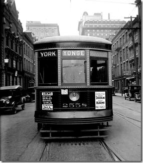 Sign boards and motor car, (front), Loews sign – May 1, 1924