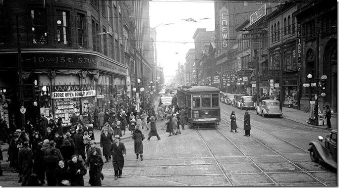 Traffic on Yonge St, looking north, from south side of Queen St; congestion as far as the eye can see and a solid line of curb parked cars, 3:26 p.m., Friday, December 20, 1935 (Traffic Study Department) – 1936