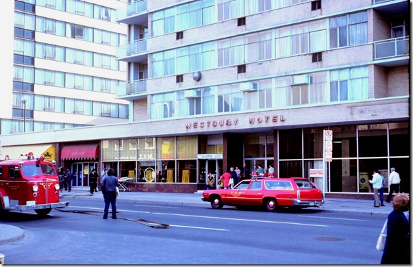 Street view of Westbury Hotel and fire trucks – May 13, 1975