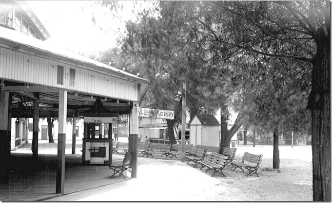 """Hanlan's Point, looking south, from """"B,"""" showing refreshment booth, dock entrance and merry-go-round, (Commercial Department) – August 12, 1927"""